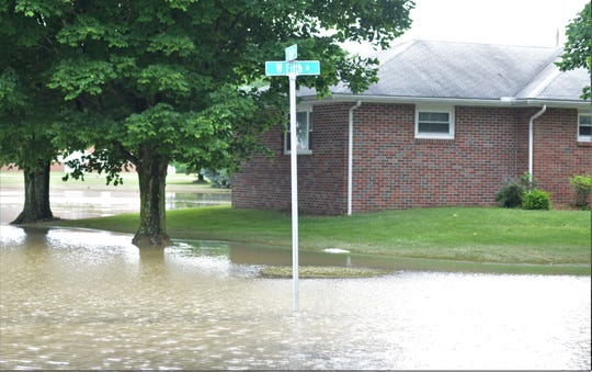 Water still remains over the road at the intersection of West Fifth and South Wall streets in West Lafayette. Several homes in the area are still being cleaned up as the water recedes.