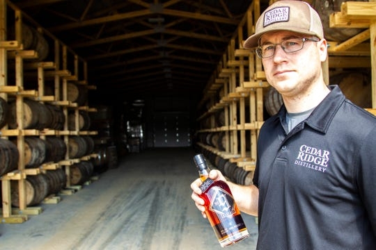 Murphy Quint, Cedar Ridge head distiller, holds a bottle of No. 9 Reserve Iowa Whiskey, Thursday, June 20, 2019, at Cedar Ridge Winery and Distillery in Swisher, Iowa.