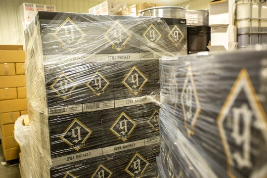 Boxes of the No. 9 Reserve Iowa Whiskey are packaged for distribution, Thursday, June 20, 2019, at Cedar Ridge Winery and Distillery in Swisher, Iowa.