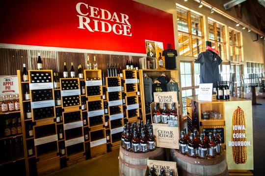 Varieties of bottles and merchandise are pictured, Thursday, June 20, 2019, at Cedar Ridge Winery and Distillery in Swisher, Iowa.