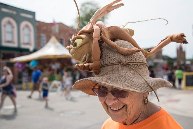 Judy Gable, a member of the New Baltimore Lions Club, shows off her hat with a homemade fishfly on top during the 2019 Bay-Rama Fishfly Festival in New Baltimore, Wednesday, June 19, 2019.