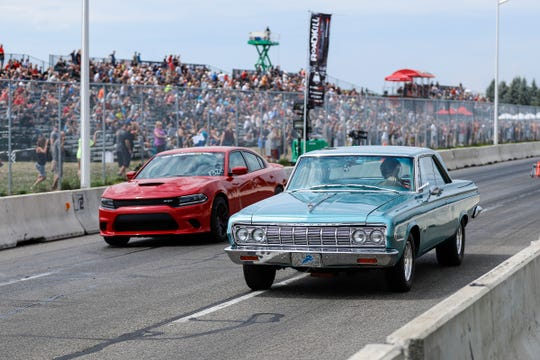 Amateur drag racers compete on a closed section of Woodward Avenue near the M1 Concourse in Pontiac during Roadkill Nights Powered by Dodge in 2018. The popular event returns to Pontiac this year.