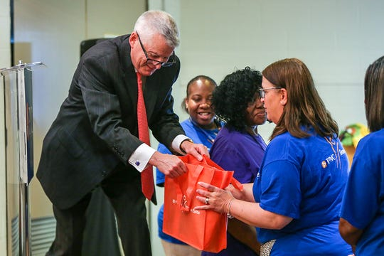 Ric DeVore, Regional President PNC Bank Detroit and Southeast Michigan, hands out iPads to Detroit Public School teachers who volunteered on the last day of school to help out during a Sesame Street Workshop national road trip's music education class in partnership with the Detroit Symphony Orchestra at Fleming Early Learning Center in Detroit on Thursday, June 20, 2019.