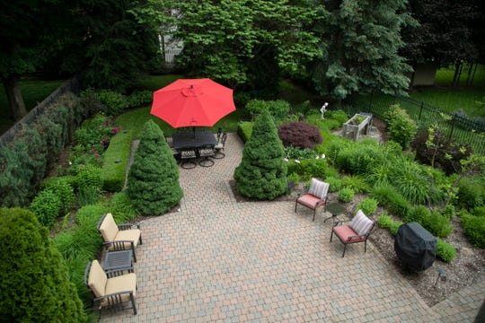 Overlooking back patio from master suite in this unique Birmingham 3 bedroom 4.5 bath home set back off of the street with a lush landscaped driveway, is listed at $1,199,500 photographed Tuesday, June 18, 2019.