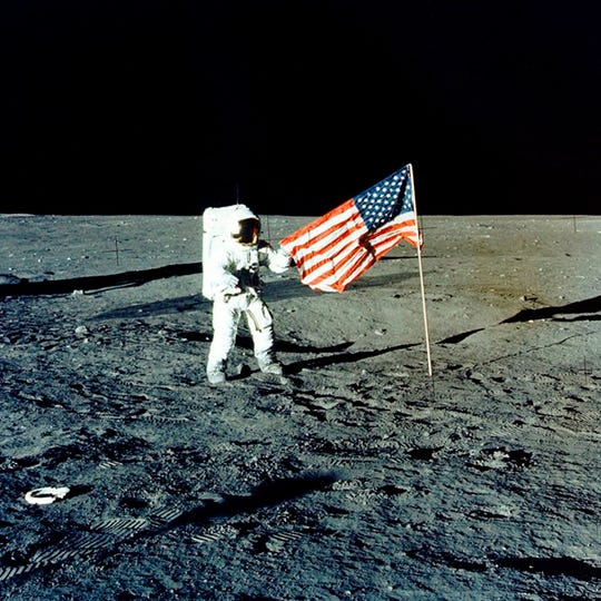 "In this November 1969 photo made available by NASA, Apollo 12 mission Commander Charles P. ""Pete"" Conrad stands on the moon's surface. A poll released Thursday, June 20, 2019 shows that Americans prefer a space program focusing on potential asteroid impacts, scientific research into our cosmos and robotic space probes over human exploration of Mars or the moon."