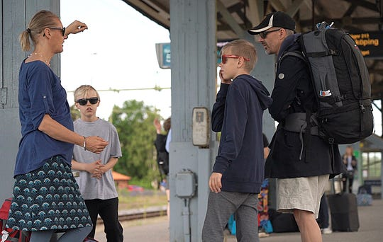 Swedish lawyer Pia Bjorstrand, her husband and their two sons await to board the first of many trains on a whistle-stop vacation around northern Europe in Nykoping.