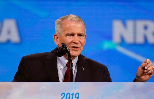 "In this April 26, 2019 photo, NRA President Col. Oliver North speaks in Indianapolis. On Wednesday, June 20, 2019, the NRA filed suit against North for what it called ""conduct harmful to the NRA."" The lawsuit said that North ""departed office after a widely publicized, failed coup attempt."""