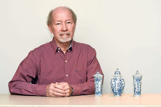 Glenn Sloan of Shelby Township shows off three pieces of Delft pottery during the Trash or Treasure event.