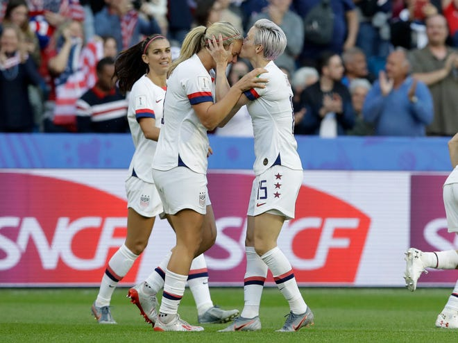 The United States' Megan Rapinoe, right, kisses teammate and goal scorer Lindsey Horan during the Women's World Cup Group F soccer match with Sweden on Thursday in Le Havre, France.