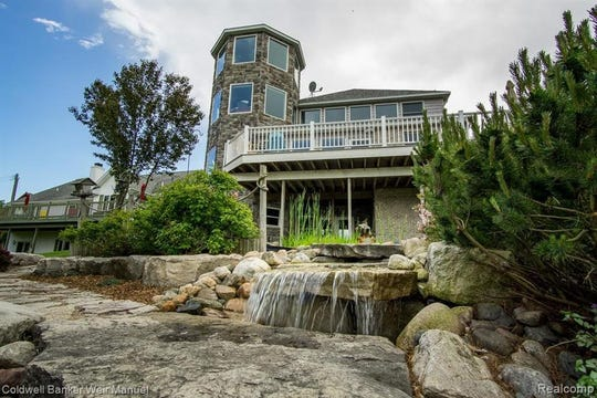 Priced at just under a million dollars, the home in Caseville is situated on overan acre of private land with waterfalls and gardens.