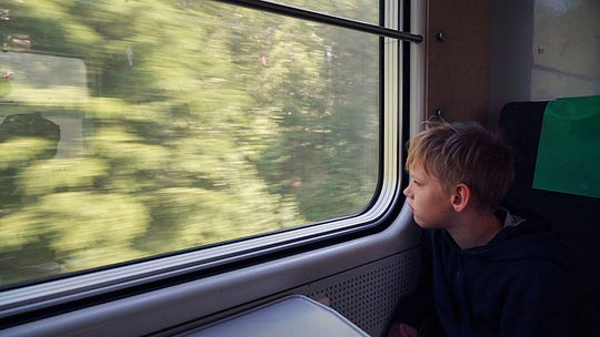 11-year-old Gabriel Bjorstrand looks out of the train window on the first of many trains on a whistle-stop vacation around northern Europe in Nykoping. Gabriel says he liked train journeys because he gets to spend time with his family, especially his brother.