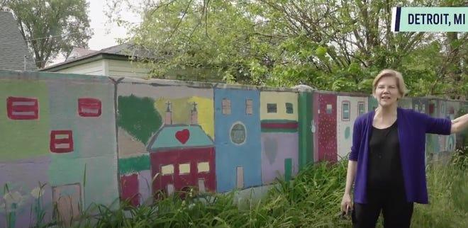Elizabeth Warren speaks about housing discrimination at Detroit's Eight Mile wall.