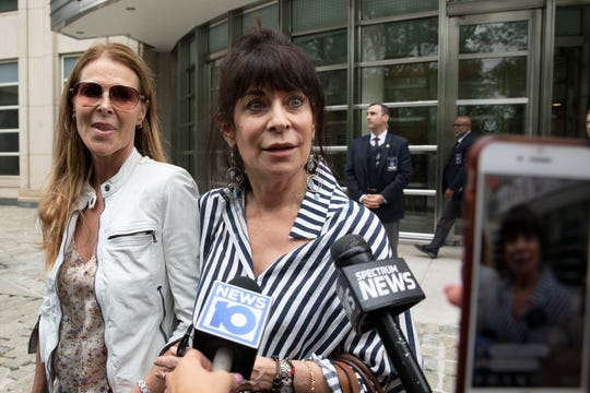 Toni Natalie, center, and Catherine Oxenberg, left, talk with the media outside Brooklyn federal court. Natalie is a former member of NXIVM and Oxenberg's daughter was a member of NXIVM.