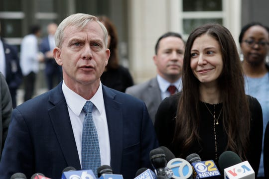 U.S. Attorney Richard Donoghue, left, talks to the media with prosecutor Moira Penza outside Brooklyn federal court after NXIVM defendant Keith Raniere was found guilty on all counts.