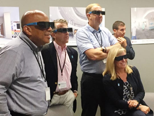At the University of Nebraska Medical Center in Omaha, members of a Southwest Indiana Chamber delegation donned 3D glasses and checked out interactive instruction technology. Pictured are, from left, University of Southern Indiana President Ron Rochon, Evansville Mayor Lloyd Winnecke, Jim Sandgren of Old National Bank, Christine Keck of Vectren and Eric Marvin of the Evansville Sports Corp.