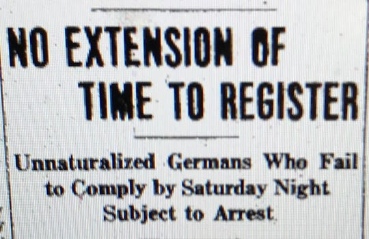 A headline from a 1918 edition of the Evansville Courier chronicling the forced registration of German immigrants during World War I.