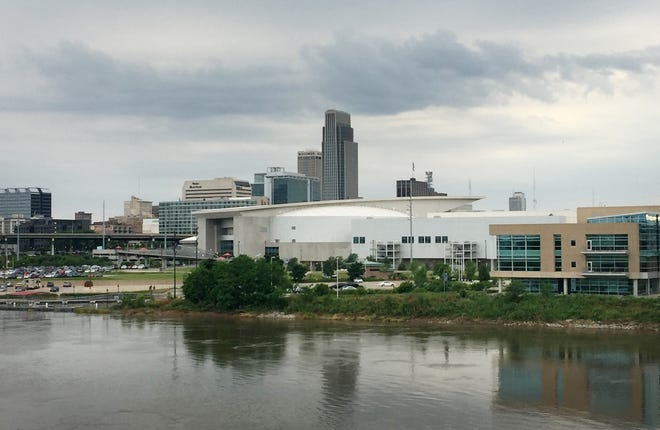 A look at the Omaha, Nebraska, skyline from a pedestrian bridge over the Missouri River. At the forefront is CHI Health Center, an arena that's home of the Creighton University basketball team and also has hosted NCAA Tournament basketball games.