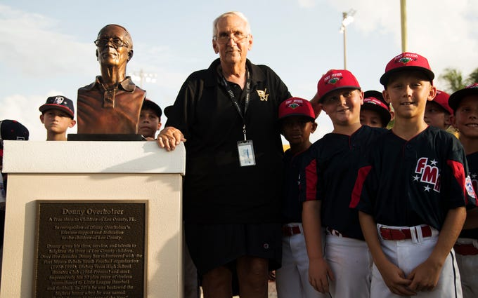 Donny Overholser, a longtime Fort Myers American Little League volunteer, is honored on Wednesday for his 50-plus years of service during a ceremony at Sam Fleishman Regional Sports Complex in Fort Myers. A bronze bust of Overholser was also unveiled.
