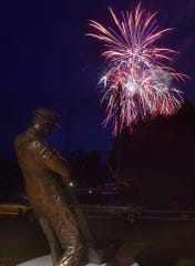 Fireworks skyrocket over a then-new bronze statue honoring commercial fishermen at Death's Door Maritime Museum in Gills Rock last July 4. The far Northern Door community hosts its annual Fourth of July celebration and fireworks show again July 4.