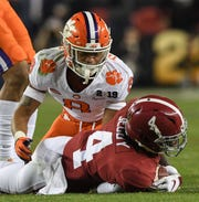 Clemson defensive back A.J. Terrell (8) tackles Alabama wide receiver Jerry Jeudy (4) during the the second quarter of the College Football Championship at Levi's Stadium in Santa Clara, California Monday, January 7, 2019.