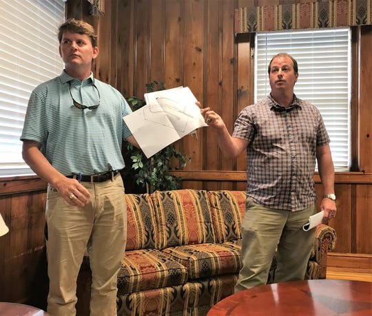 Jay Beeson, left, and Joe Waldron of Mark III Properties in Spartanburg show Piedmont residents attending a community meeting on Wednesday, June 19, 2019, a plan for how they could theoretically build 18 homes o nan 11-acre lot north of Furr Road in Piedmont. The men said their plan to develop 147 lots south of Furr Road fits the area's market demands.