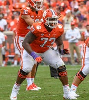 Clemson offensive lineman Tremayne Anchrum (73) blocks near quarterback Trevor Lawrence (16) during the second quarter in Memorial Stadium in Clemson on September 1.