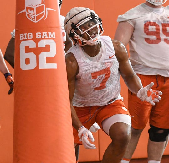 Clemson defensive end Justin Mascoll(7) gets ready to hit a blocking dummy during the first practice at the Clemson Indoor Practice Facility in Clemson Wednesday, February 27, 2019.