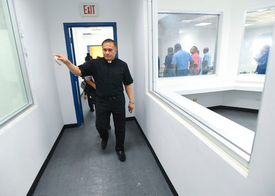 Monsignor James Benavente sprinkles Holy water as he blesses the interior of the Guam Police Department's new Central Precinct Command in Sinajana on Thursday, June 20, 2019. A ribbon cutting ceremony was held earlier to celebrate the opening of the facility.