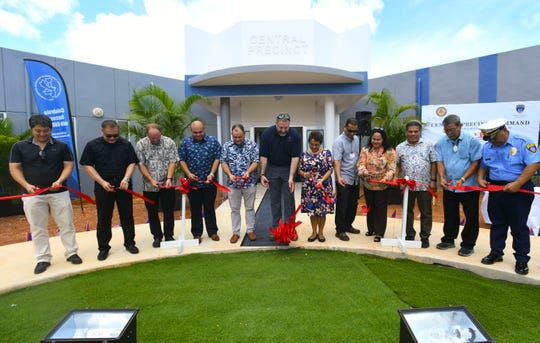 Gov Lou Leon Guerrero, government officials, visiting U.S. Department of Housing and Urban Development officials and other gather for a ceremonial ribbon cutting to celebrate the opening of the Guam Police Department's new Central Precinct Command in Sinajana on Thursday, June 20, 2019.