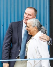 During the grand opening celebration for Cleo's Bodega, Indianapolis Mayor Joe Hogsett, left, hugs Sara Blackburn, the daughter of Cleo Blackburn, a former executive director of Flanner House, for which Cleo's Bodega is named, on Thursday, June 20, 2019.
