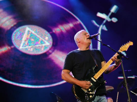David Gilmour is seen playing his 1969 black Fender Stratocaster during 2005's Live 8 benefit concert in London.
