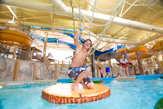 A child plays on the lily pads of Big Foot Pass at the Great Wolf Lodge in Mason, Ohio.