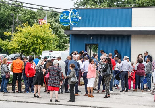 Guests gather during the grand opening of Cleo's Bodega, located in front of Flanner House Community Center, which will serve as a food access hub for the community on Thursday, June 20, 2019. The Bodega, located in the largest food desert in Indianapolis, will be staffed by neighborhood and community members through the Flanner House Community Center for Working Families Program, and stocked with produce from the produce from Flanner House, Urban farmers, and Brandywine Creek Farms organic farming initiatives.