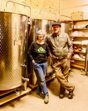 Black Diamond Farm's Ian and Jackie Merwin in their cidery's tank room.