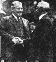 Pennsylvania Gov. William Sprout, left, shakes the hand of New York Gov. Nathan Miller at the opening of the Lackawanna Trail in 1922.