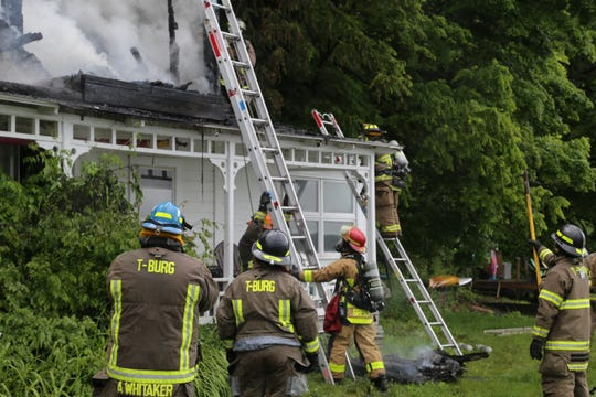 Firefighters work on putting out a blaze in the Maplewood Point Road and Maplewood Road area in Ulysses near Cayuga Lake