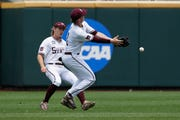 Mississippi State shortstop Jordan Westburg, right, and left fielder Rowdey Jordan (4) drop a fly ball hit by Vanderbilt's JJ Bleday for a base hit, in the first inning of an NCAA College World Series baseball game in Omaha, Neb., Wednesday, June 19, 2019.