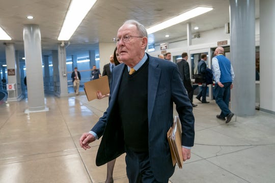 "In this Feb. 12, 2019, file photo, Sen. Lamar Alexander, R-Tenn., walks to the Senate at the Capitol in Washington. A new study says about once in every six times someone is taken to an emergency room or checks in to a hospital as an in-patient, the treatment is followed by a ""surprise"" medical bill."