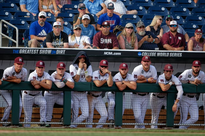 Mississippi State players watch the ninth inning against Vanderbilt from the dugout, in an NCAA College World Series baseball game in Omaha, Neb., Wednesday, June 19, 2019. Vanderbilt won 6-3.