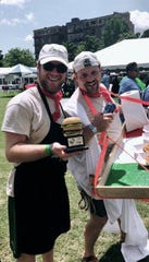 "Hickory Construction employees Tyler Fest & Ben Pinnell celebrate ""Most Team Spirit"" Award at 2018 ETCH Burger Bash."