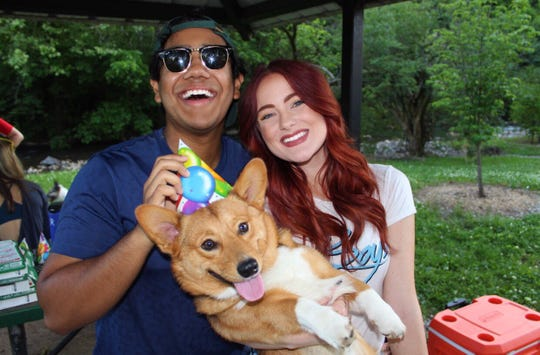 """Knoxville """"Big Brother"""" contestant Ovi Kabir and his girlfriend Hannah Blackwell pose for a photo with their corgi, Mowgli."""