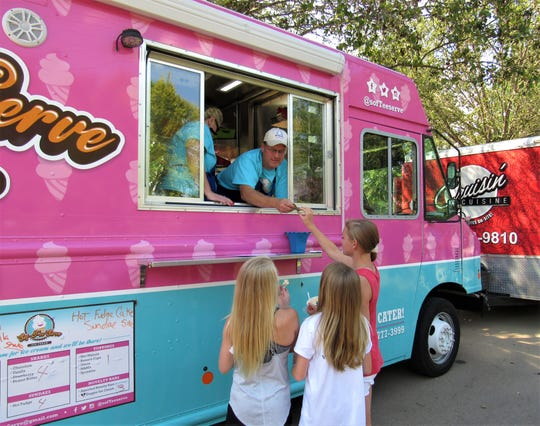 Young customers lined up at the Sof-Tee-Serve ice cream truck during the Lawn Chair Concert Series on June 14 at Founders Park.