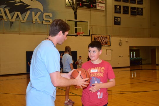 Coach Shane Chambers gives pointers to William Speed, 12, at the Hardin Valley Academy basketball camp. 06/20/19