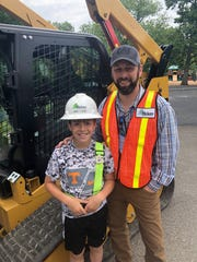"Hickory Construction's Randy Fields with his son Evan at Bearden Elementary School ""Careers on Wheels"" Day."