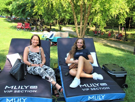 Enjoying the concert in style, Amy Beron and daughter Blakely were VIPs on custom chaise lounges after winning a contest sponsored by the luxury mattress company MLILY. The newly opened retail store is in Village Green Shopping Center.
