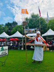 Hickory Construction chairman Burke Pinnell peddling burgers at the 2018 ETCH Burger Bash.