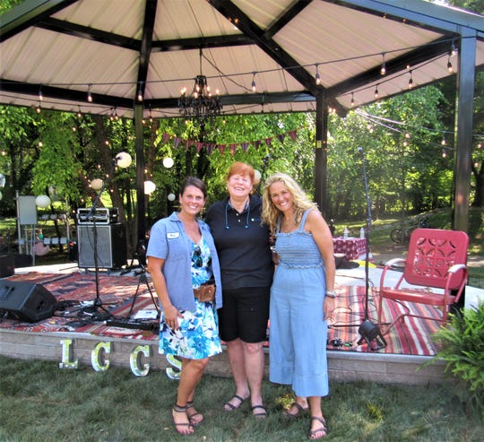 Lawn Chair Concert Series founders Shandy Dixon and Amy Boling greeted Parks and Leisure Director Sue Stuhl, center. From the beginning, Stuhl was committed to helping make the concerts a free, family-friendly event.