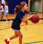 Sarah Galloway, 9, dribbles the ball down court. 06/20/19