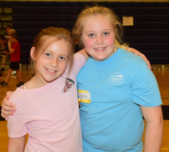 "Best friends Reagan Chitty, 9, and Emily Wright, 9, take a break from making baskets at the Hardin Valley basketball camp. ""It's the most fun I've ever had,"" said Reagan. 06/20/19"