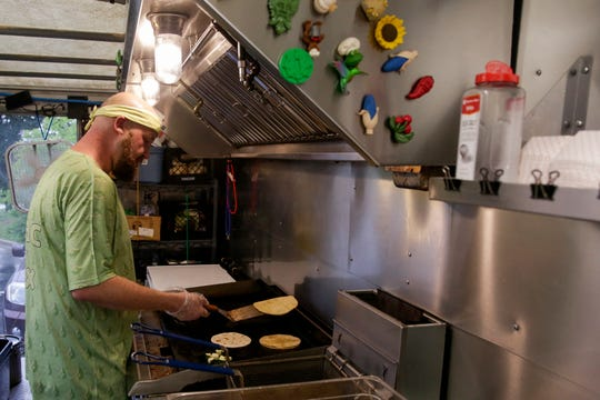 Matt Bestich, Guac Box owner, prepares tacos inside the food truck at the West Lafayette Farmers Market, Wednesday, June 19, 2019 in West Lafayette.